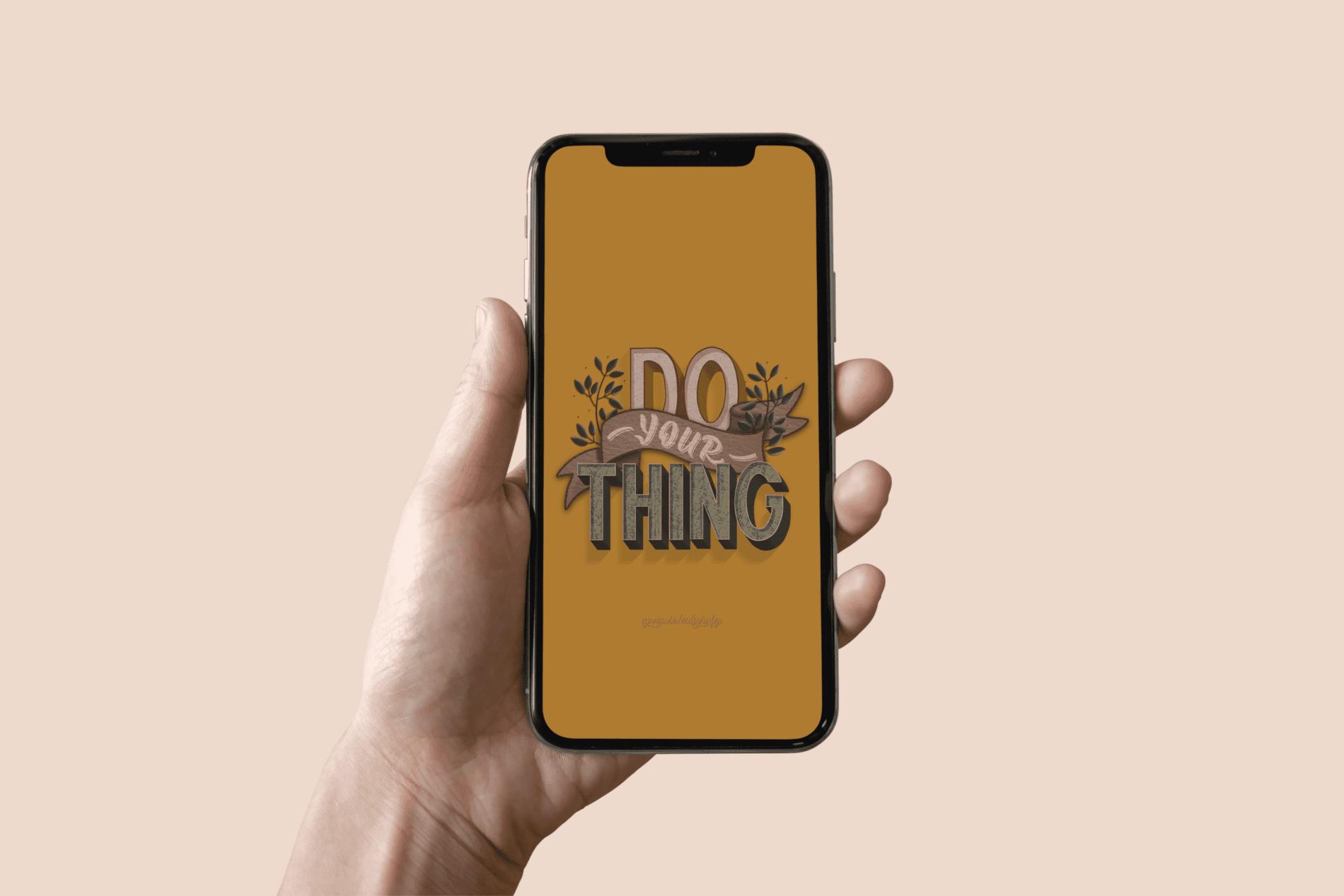 Imagem de um celular com a frase Do your thing em Hand lettering com folhagem e banner